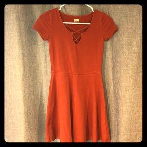 Dark orange hollister dress, fit and flare style.